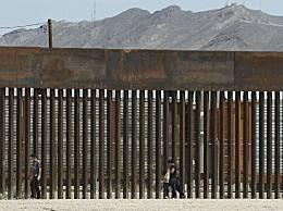 非法移民破墙入美 人贩团伙毁坏边境隔离墙