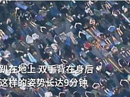 抗议者模仿黑人男子生前最后姿势