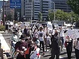日本多地爆发游行