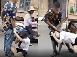 男子当街扯头发抱摔暴打妻子