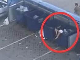 俄罗斯男子将女友扔垃圾桶