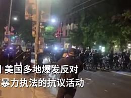 美国警察推自行车从示威者头上碾过