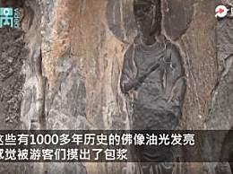 洛阳龙门石窟佛像被游客摸出包浆