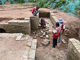 广州一中学发现125座古墓