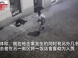 维也纳恐袭:蒙面人端长枪挎手枪