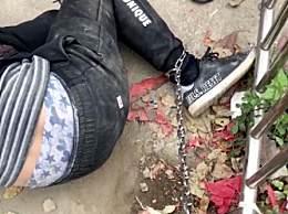 柳州男子偷狗被抓被拴铁链
